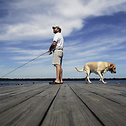 Recently retired Jerry Gedert spends his morning fishing off the dock at Alum Creek State Park's Cheshire boat launch area with his 3-year-old lab Hunter Riley on July 22. Gedert says Hunter isn't much help catching bluegill or bass, but the dog enjoys swimming in the reservoir before and after fishing.