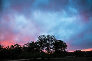 Storm clouds at sunset in Concan, Texas in spring.
