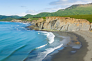 Waves wash ashore at Fossil Beach and Surfing Beach at Pasagshak State Recreation Site on Kodiak Island  in Southwestern Alaska. Summer. Afternoon.