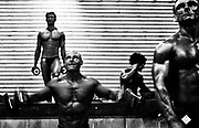 BODYBUILDING<br /> I covered the Australian Bodybuilding Championships for a couple of years .Initially I was intrigued by these people who undertook extreme exercise,diet and weight regimes to sculpt their bodies way beyond that of the average human body. From day one my first thought , after a fleeting feeling of intimidation on being surrounded by these massive frames, was that these bodybuilders were extremely dedicated and driven athletes.<br /> <br /> Date..30th October 2005 <br /> Pixs taken during the &quot;2005 AUSTRALIAN BODYBUILDING CHAMPIONSHIPS &quot; at Revesby Workers Club , (3 Brett Street Revesby).which also incorporated BODYSHAPING, FITNESS and FIGURE..<br /> <br /> Images were taken down in the so called &quot;PIT&quot; where competitors got ready , pumped themselves up and rubbed fake body tan on etc. There are also pixs of competitors in the small makeup rooms just off to the side of the stage where they check themselves out, practice their poses, and make final adjustments before going onto the stage to compete.Finally there are pixs of them on stage .The event was a PAUL and CAROL GRAHAM Production.