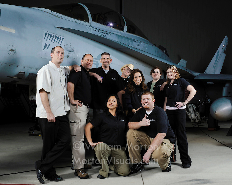 Group portraits in front of an F/A-18 Hornet at MCAS Miramar, with photos printed on the spot. Event photography by Dallas event photographer William Morton.