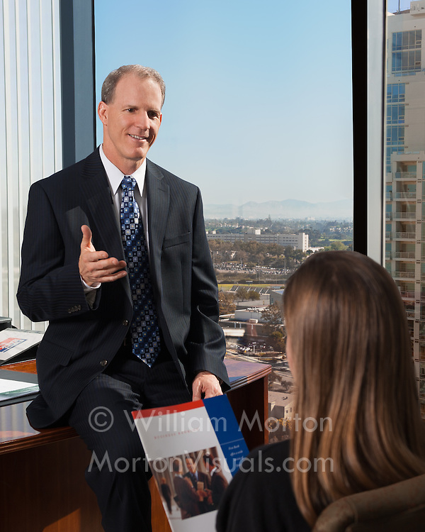 Senior Vice President and Regional Manager Bob Jondall consults with a First Bank commercial banking client in his San Diego office. Corporate executive photography by Dallas corporate photographer William Morton of Morton Visuals.