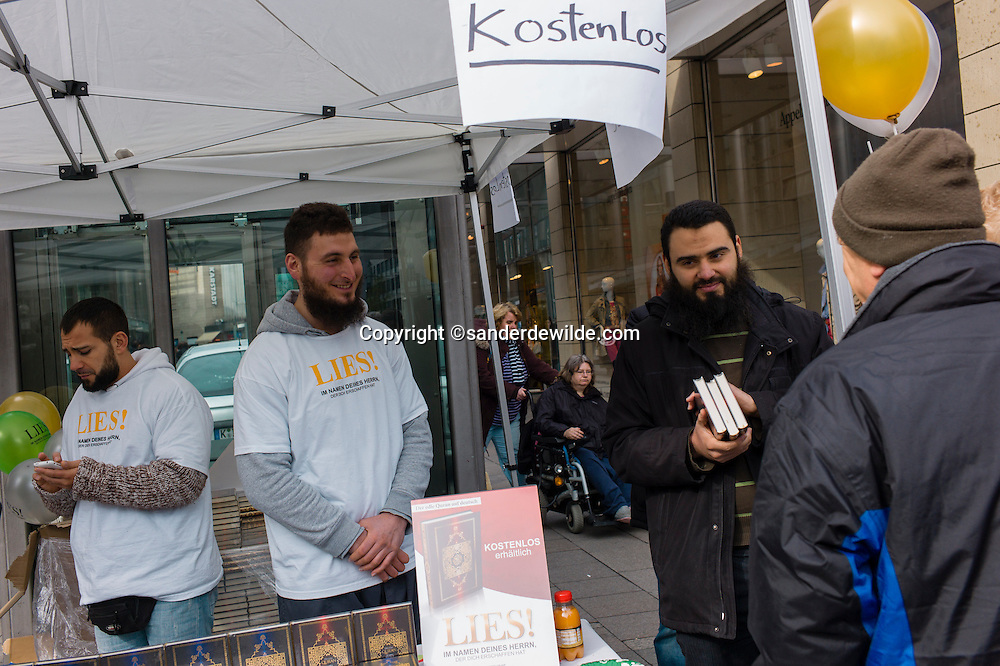 Cologne, Germany 7th April 2012. Lies! in namen des herren is written on the t-shirt of this muslim handing out the koran  for free in the shopping district of Cologne. It means, lies, in the name of your god.