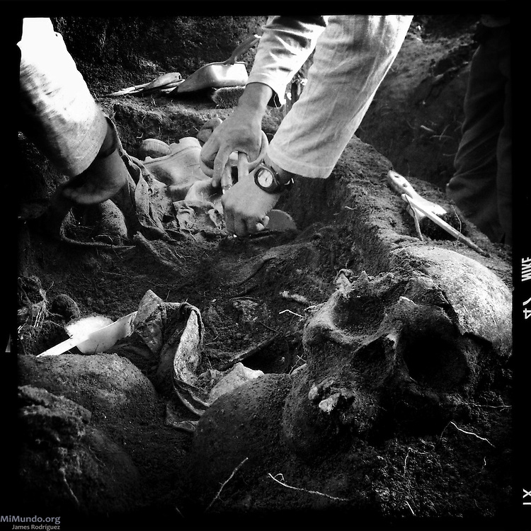 Human remains are exhumed from a mass grave at the former military garrison of San Juan Cotzal in the Mayan Ixil region of Quiché. The exhumation carried from August to November, 2014, by members of the Forensic Anthropology Foundation of Guatemala (FAFG) rendered the skeletal remains of 74 people presumed to have disappeared during the country's internal armed conflict (1960-1996). Cotzal, Quiche, Guatemala. November 6, 2014.