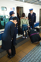 JR Staff Bowing to Passengers - The Shinkansen is a network of high speed railway lines in Japan operated Japan Railways.  Starting with the 210 km/h  Shinkansen in 1964 the now 2,500 km long network has expanded to link most major cities on the islands of Honshu and Kyushu at speeds up to 300 km/h.
