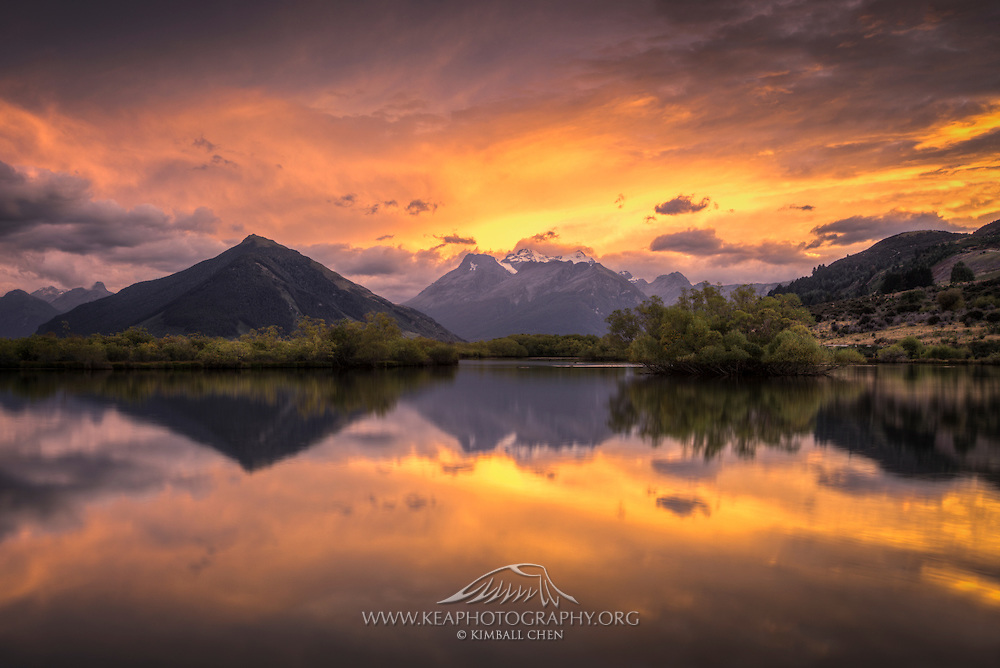 A fiery sunrise appears to set Mount Earnslaw ablaze, as viewed from Glenorchy Lagoon, South Island, New Zealand.