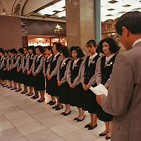 Female clerks at Tokyo's Mitsukoshi department store receive their daily instructions from a male supervisor. Most salespeople here and in other retail stores are women.
