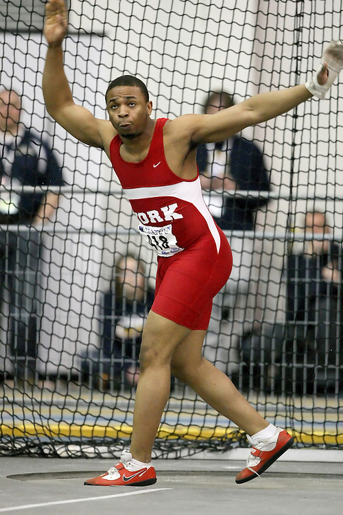 Windsor, Ontario ---13/03/09--- Suyi Georgewill of  York University competes in the men's weight throw at the CIS track and field championships in Windsor, Ontario, March 13, 2009..Sean Burges Mundo Sport Images