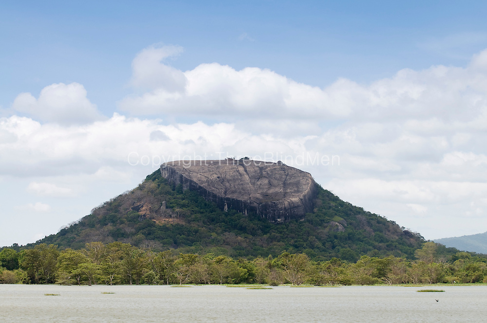 Sigiriya (Lion's rock) is an ancient rock fortress and palace ruin situated in the central Matale District of Sri Lanka, surrounded by the remains of an extensive network of gardens, reservoirs, and other structures.