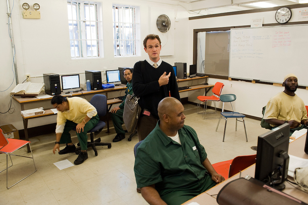 """Max Kenner in the computer room at Woodbourne Correctional Facility. Max is the brainchild behind the privately funded Bard College  Initiative for prison inmates...Story: The Bard Prison Initiative.Former inmate Carlos Rosario, 35-year-old husband and father of four, was released from Woodbourne Correctional Facility after serving more than 12 years for armed robbery. Rosado is one of the students participating in the Bard Prison Initiative, a privately-funded program that offers inmates at five New York State prisons the opportunity to work toward a college degree from Bard College. The program, which is the brainchild of alumnus Max Kenner, is competitive, accepting only 15 new students at each facility every other year. .Carlos Rosario received the Bachelor of Arts degree in social studies from the prestigious College Saturday, just a few days after his release. He had been working on it for the last six years. His senior thesis was titled """"The Diet of Punishment: Prison Food and Penal Practice in the Post-Rehabilitative Era,"""".Rosado is credited with developing a garden in one of the few green spaces inside the otherwise cement-heavy prison. In the two years since the garden's foundation, it has provided some of the only access the prison's 800 inmates have to fresh vegetables and fruit...Rosario now works for a recycling company in Poughkeepsie, N.Y...Photo © Stefan Falke"""