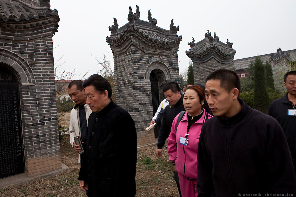 Grandmaster Chen Xiaowang (left) and master Chen Ziqiang (right) during a visit to their family's ancestral graves where together with other members of their family they will pay their respects to their ancestors with a ceremony.