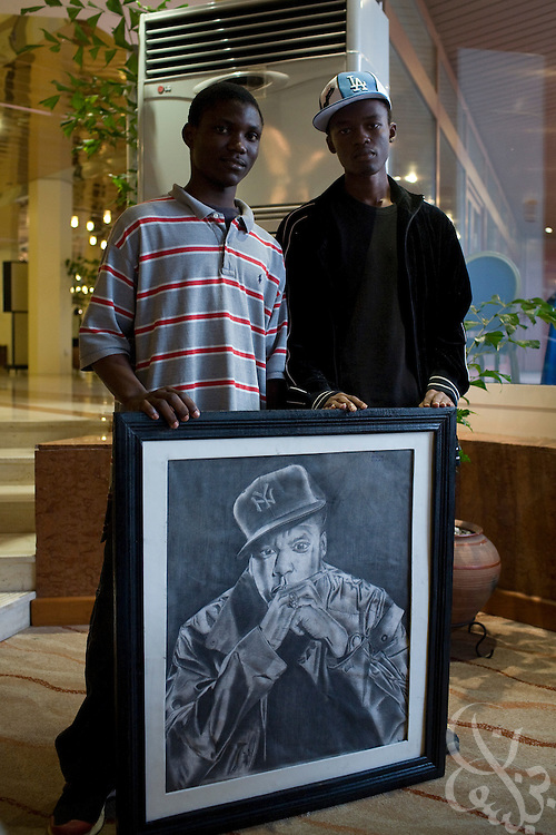 Nigerian teenagers Modesty Amaechi & Shalom Nwaokolo hold their pencil drawn portrait of hip hop artist Jay-Z July 11, 2008 in the Hilton hotel lobby in Abuja, Nigeria. The two teens brought the portrait to the hotel in the hopes of meeting the hip hop star, who is in Abuja to perform at the annual ThisDay festival. The three year old festival is an effort to raise awareness of African issues while promoting positive images of Africa using music, fashion and culture...