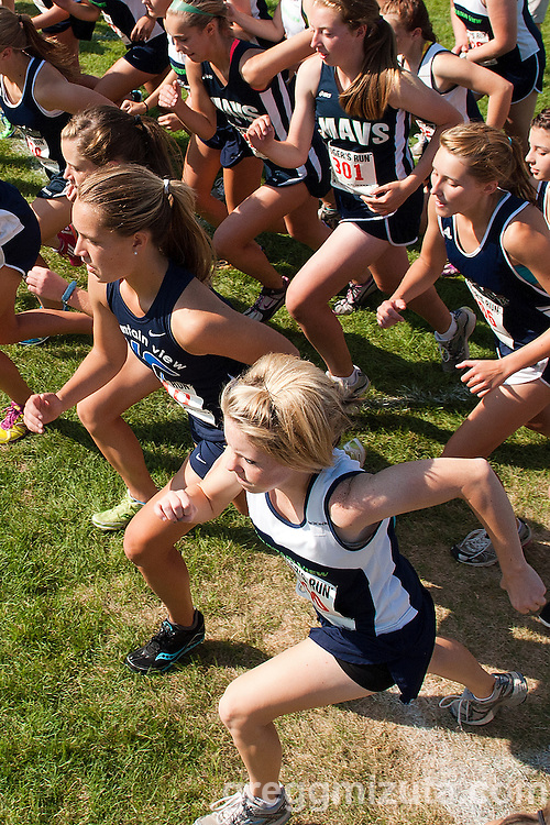 Emily Blake (blue top) and Kara Wayment (white top) at the start of the Roger Curran Memorial Run girl's junior varsity 5k race at West Park in Nampa, ID on September 10, 2011. Blake finished second (21:24.46) and Wayment eleventh (22:57.70).