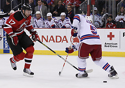 Mar 25, 2010; Newark, NJ, USA; New Jersey Devils left wing Ilya Kovalchuk (17) moves the puck between the legs of New York Rangers defenseman Daniel Girardi (5) during the first period at the Prudential Center.