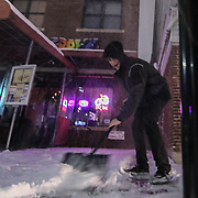 Ryan Brish shovels snow as snow falls Friday, Jan, 22, 2016 at Home Grown Caf&eacute; in Newark.<br /> <br /> A massive blizzard dumps snow in Newark, and eastern United States on Friday, with mass flight cancellations, five states declaring states of emergency.