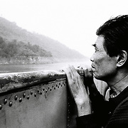 A man looks to out from a boat in the Yangtze river as the water level keeps rising in the Yangtze river.