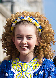 London, March 13th 2016. The annual St Patrick's Day Parade takes place in the Capital with various groups from the Irish community as well as contingents from other ethnicities taking part in a procession from Green Park to Trafalgar Square.  PICTURED: A little girl in traditional Irish dress waits for the parade to begin. &copy;Paul Davey<br /> FOR LICENCING CONTACT: Paul Davey +44 (0) 7966 016 296 paul@pauldaveycreative.co.uk