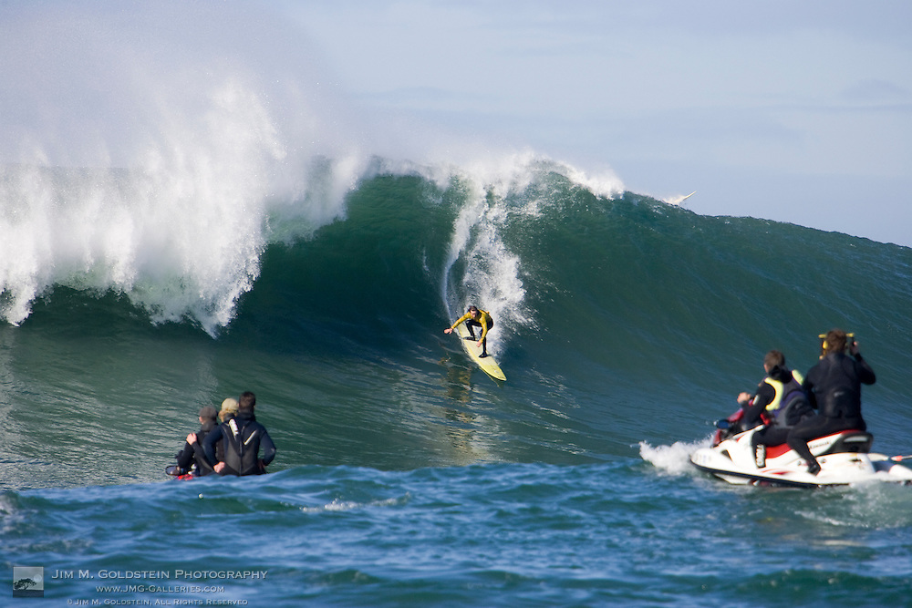 """Grant """"Twiggy"""" Baker descends a wave in Heat 6 of the 2008 Mavericks Surf Contest on January 12 2008"""