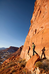 Man hiking in Capitol Reef National Park.