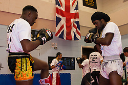 North Woolwich, London, October 28th 2014.  The Mayor of London, Boris Johnson, visits a training session at Fight for Peace Academy in Newham.<br /> <br /> Fight for Peace uses boxing and martial arts combined with education and personal development to realise the potential of young people in the borough at risk of crime and violence. First established in Rio in 2000 by Luke Dowdney MBE, it was replicated in Newham in 2007. It is now expanding globally and began rolling out across the UK.<br /> Pictured: Youth at Fight For Peace practice their kick boxing as they await the arrival of Boris Johnson.