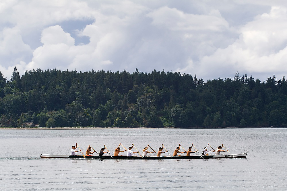 An 11-man outrigger canoe races in the 61st Annual Lummi Stommish Water Festival at the Lummi Indian Reservation, Washington.