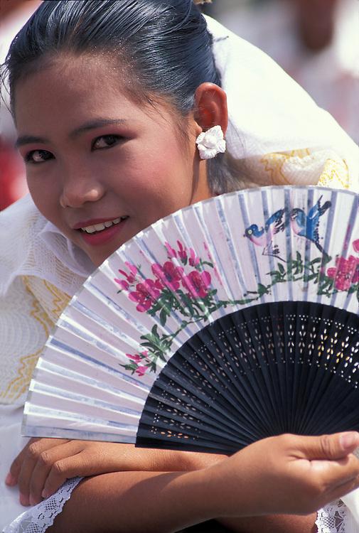Philippines, Cebu Island, Young girl in traditional costume at Sinulog parade near Cebu City.