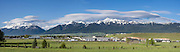See the snowy Wallowa Mountains and Eagle Cap Wilderness from Log House RV Park, Enterprise, Oregon, USA. This panorama was stitched from 4 overlapping images.