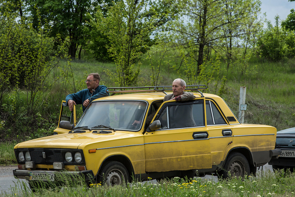 SLOVYANSK, UKRAINE - MAY 5: People wait in line for soldiers check vehicles on their way into town at a Ukrainian military checkpoint on the edge of town on May 5, 2014 in Slovyansk, Ukraine. Slovyansk is one of many cities across Eastern Ukraine that have been overtaken by pro-Russian protesters in recent weeks, leading the Ukrainian military to respond with force in some areas. (Photo by Brendan Hoffman for The Washington Post)