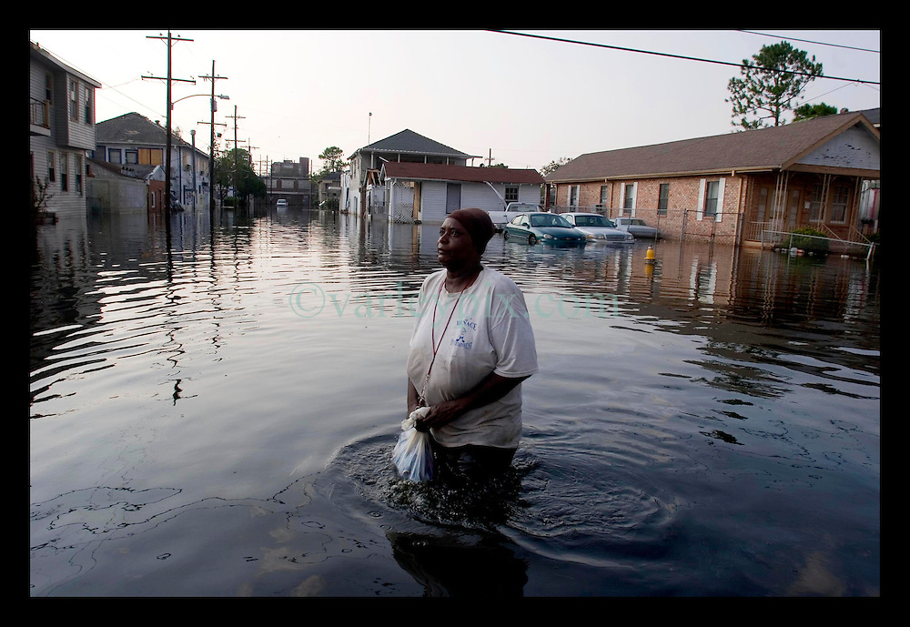 5th Sept, 2005. Hurricane Katrina aftermath. New Orleans. Residents who refuse to leave. A lady wades through the water where some residents of Uptown New Orleans resuse to leave the devastated flood areas.