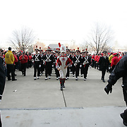 COLUMBUS, OH - November 18 2006: Fans yell and cheer for The Ohio State Marching Band outside Ohio Stadium before The Ohio State Buckeyes play the Michigan Wolverines. Credit: Bryan Rinnert