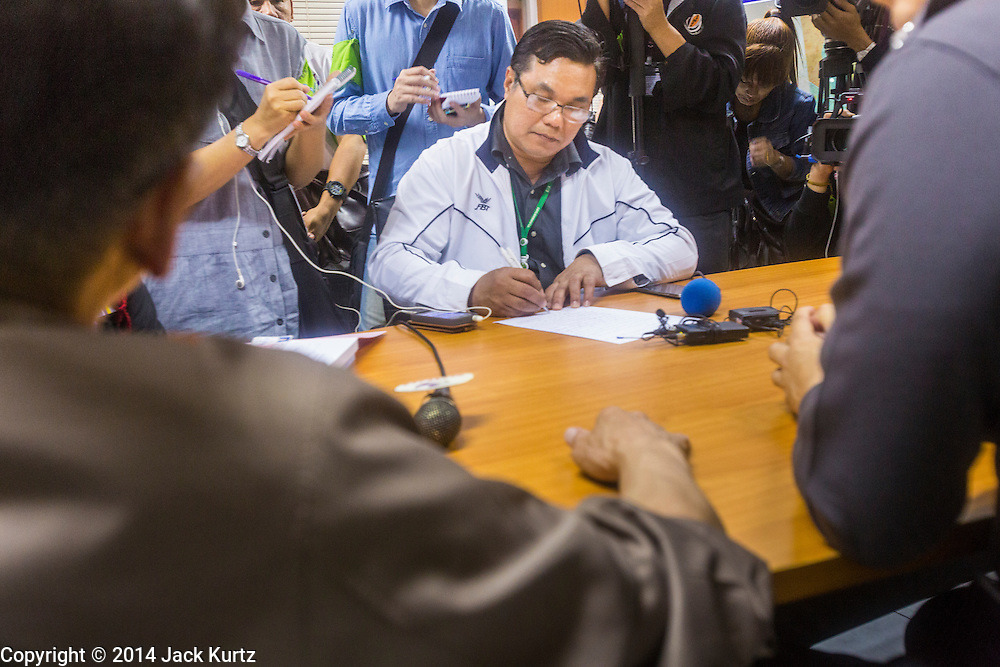 26 JANUARY 2014 - BANGKOK, THAILAND: SIM NITITADURAL, Executive Director of the Bang Kapi District polling place, files a police report about the closure of the polling place by anti-government protestors in Bangkok. Anti-government protestors forced the closure of polling places in Bangkok Sunday as a part of Shutdown Bangkok. Early voting was supposed to be Sunday January 26 but blocked polling places left hundreds of thousands of people unable to vote casting the February 2 general election into doubt and further gridlocking Thai politics. Protestors blocked access to gates and entry ways to polling places and election officials chose the close them rather than confront protestors. Shutdown Bangkok has been going for 12 days with no resolution in sight. Suthep, the leader of the anti-government protests and the People's Democratic Reform Committee (PDRC), the umbrella organization of the protests,  is still demanding the caretaker government of Prime Minister Yingluck Shinawatra resign, the PM says she won't resign and intends to go ahead with the election.    PHOTO BY JACK KURTZ