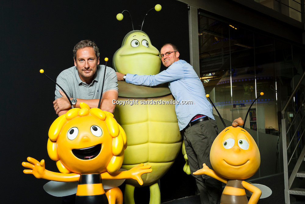 Schelle, Belgium 2012 26th September. Hans Bourlon (right) and Gert Verhulst (left) own media house Studio 100. In its 4 TV studios multiple successful characters were given life: Samson & Gert, Plop the Gnome, Pirate Pete?activities of Studio 100 are animation, live action, Feature films, games, publishing, stages show and theme parks.Here they pose with character Maya the bee, and turtle Kurt.