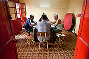 A game of cards in progress in an old Chinese Association in Chinatown, Port Louis.