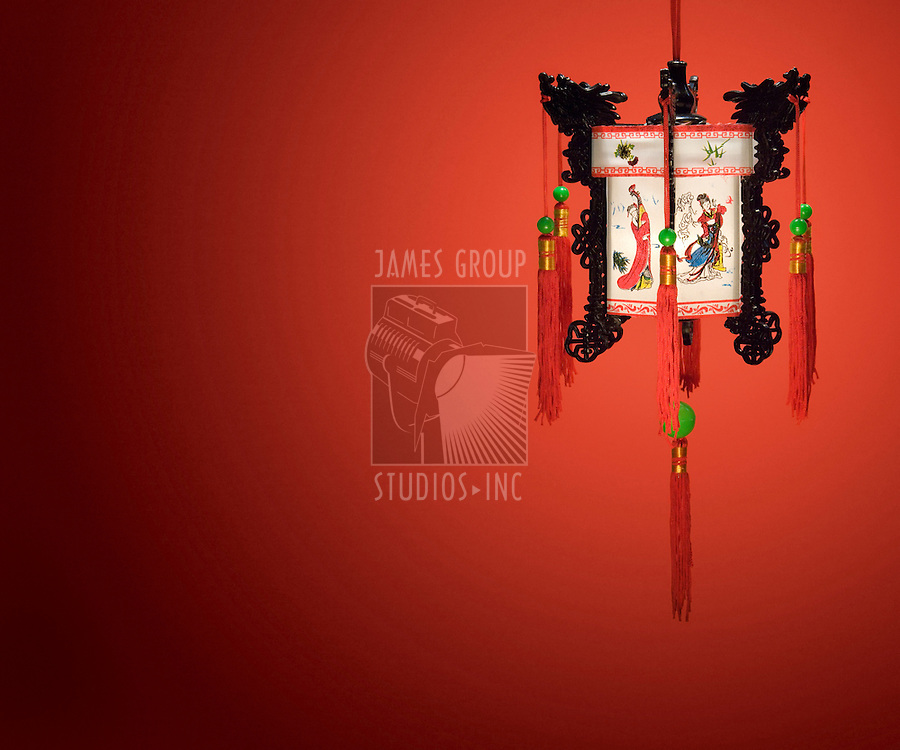 Chinese lantern hanging against a red background