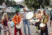 Playing drums and dancing on the shore of the sea of Galilee