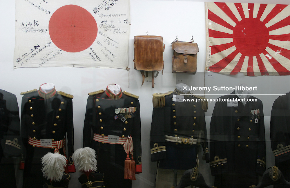 JAPANESE MILITARY UNIFORMS AND FLAGS, Photographed at the Special Attack Peace Memorial Museum, in Chiran, Kyushu Island, Southern Japan.. Chiran was the airbase from where kamikaze pilots took off on their final missions.