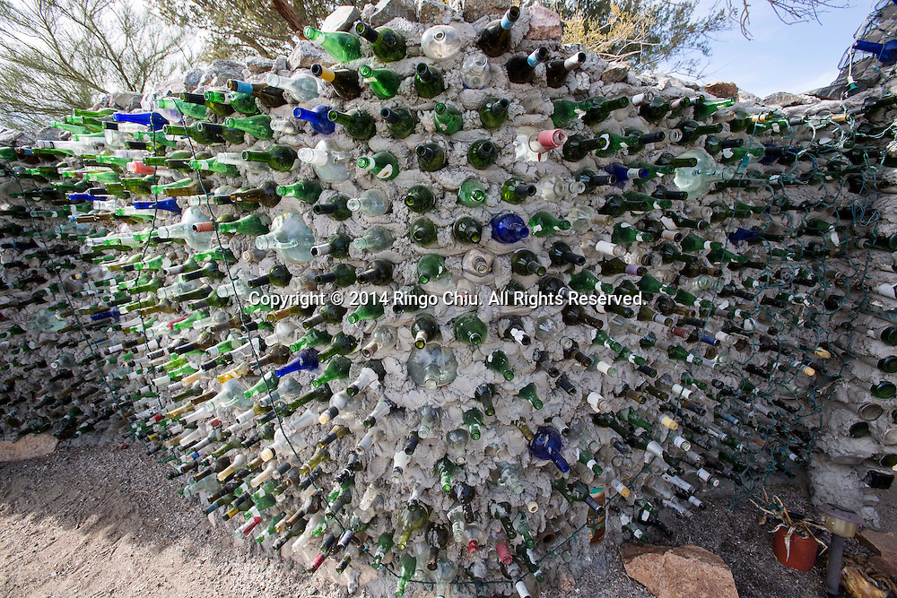 """An art work """"Bottle Wall"""" is displayed at East Jesus, an experimental, habitable, extensible artwork gallery, on  January 4, 2014, in Slab City, California. Slab City or The Slabs is a snowbird campsite in the Colorado Desert in southeastern California, used by recreational vehicle owners and squatters from across North America. It takes its name from the concrete slabs that remain from the abandoned World War II Marine barracks of Camp Dunlap. (Photo by Ringo Chiu/PHOTOFORMULA.com)"""