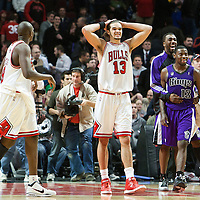 21 December 2009: Chicago Bulls center Joakim Noah looks dejected while Sacramento Kings guard Tyreke Evans celebrates during the Sacramento Kings 102-98 victory over the Chicago Bulls at the United Center, in Chicago, Illinois, USA.