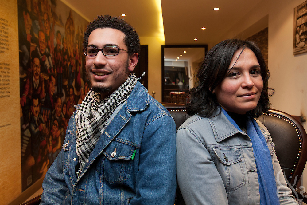 Egyptian activists Michael Adel (l) and Dai Rahmy (r) pose for a portrait in a cafe in central Cairo January 17, 2012.
