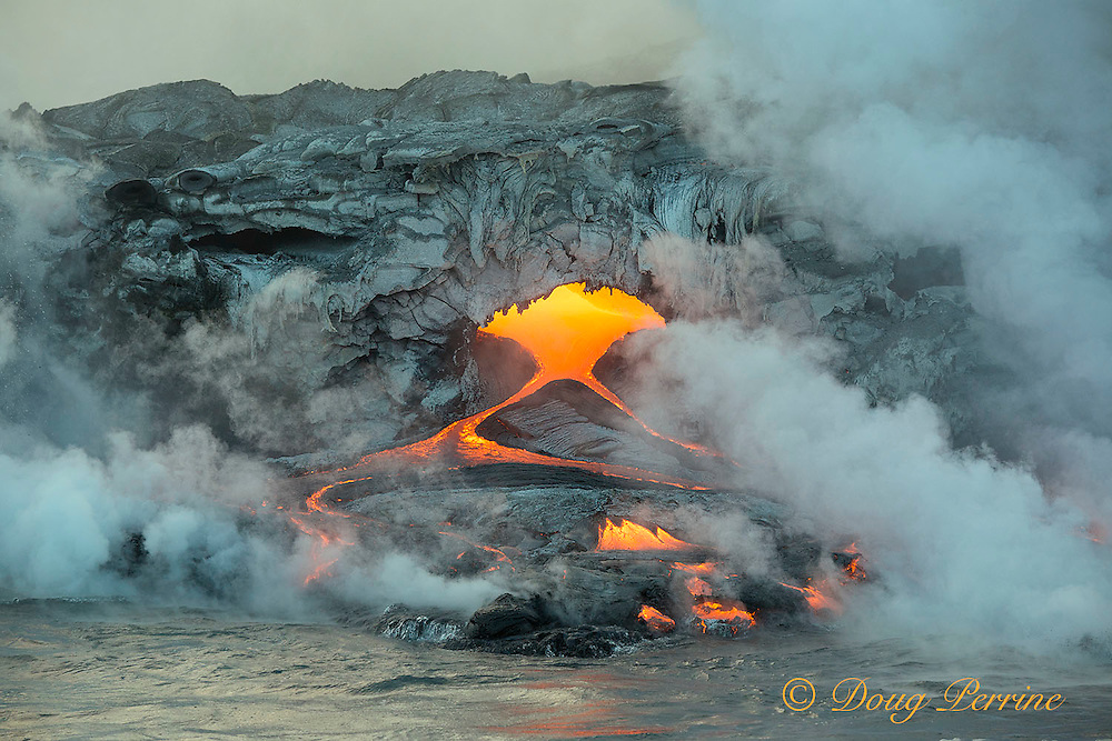 hot lava from Kilauea Volcano erupting from coastal lava tubes, enters the ocean offshore from Hawaii Volcanoes National Park, Puna, Hawaii ( the Big Island ), Hawaiian Islands, U.S.A. ( Central Pacific Ocean )