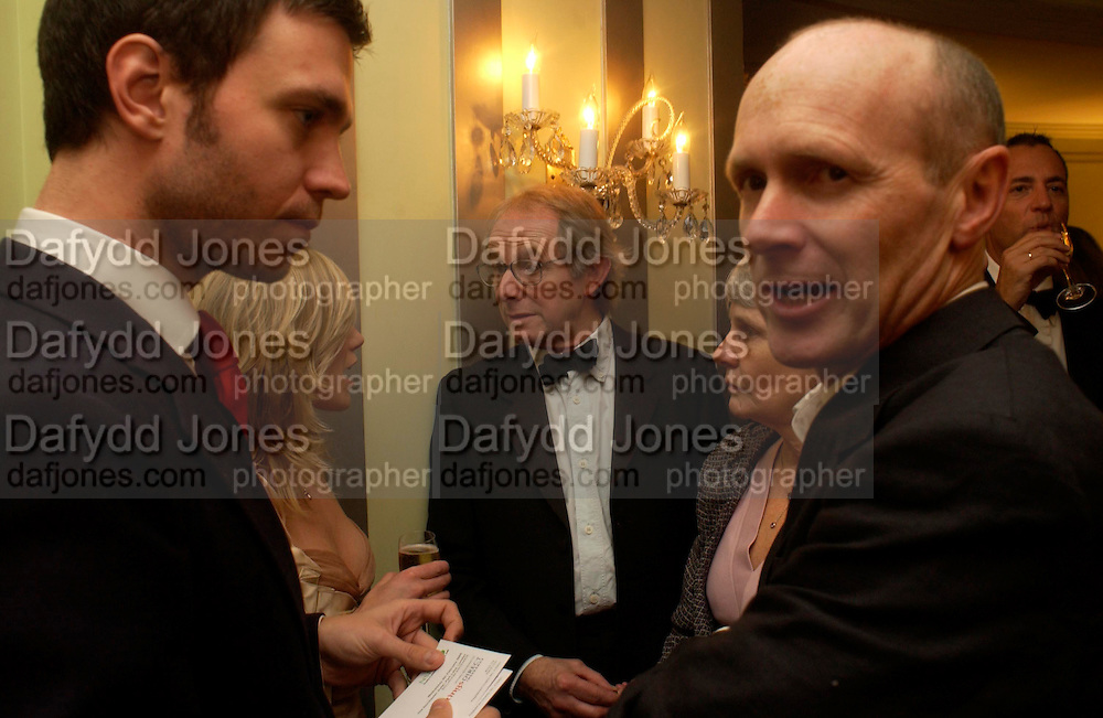 Raife Burdell, Eva Birthistle, Ken Loach and  Mrs.. 25th  annual Awards of the London critic's Circle in aid of the NSPCC. The Dorchester. Park Lane. London. 9 February 2005. ONE TIME USE ONLY - DO NOT ARCHIVE  © Copyright Photograph by Dafydd Jones 66 Stockwell Park Rd. London SW9 0DA Tel 020 7733 0108 www.dafjones.com