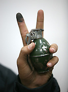 A member of  Hamas shows a grenade and his finger still stained by the ink used to mark his ballot in the elections as Hamas  celebrated in Gaza City January 26,2006. The Islamic Resistence Movement triggered a political earthquake with a sweeping victory in the Palestinian general elections. Hamas won a massive 76 of 132 seats i teh Ramallah-based parliament , while the long-dominat fatah faction won just 43. (Photo by Heidi Levine/Sipa Press).