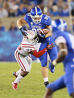 September 15, 2012 - Lexington, Kentucky, USA - UK's TYLER ROBINSON is tackled by WKU's KIANTE YOUNG after a short gain in the second half as Western Kentucky University defeated the University of Kentucky, 32-31, on a trick play in overtime. (Credit Image: © David Stephenson/ZUMA Press).