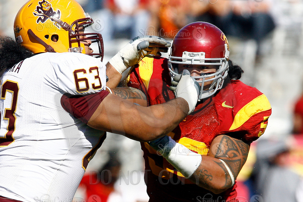 11 October 2008: #58 Rey Maualuga has his facemask grabbed by Paul Fanaika during the NCAA Pac-10 USC Trojans 28-0 shut-out win over the Arizona State University Sun Devils during a day college football game at the Los Angeles Memorial Coliseum in Southern California.