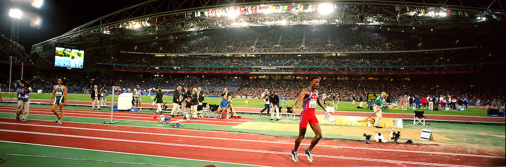 A panoramic image of Iván Pedroso, Cuba, winning the Gold medal in the Men's Long Jump during the 2000 Sydney Olympic Games...Panoramic images from the Sydney Olympic Games, Sydney, Australia.  2000 . Photo Tim Clayton