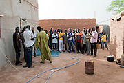 Ali( in green), Boss partner and his team, calling the migrants to give them their truck tickets to Dirkou, Niger