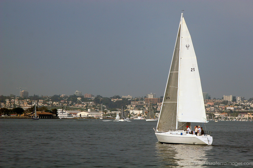 Boats sail on a windy day in San Diego Harbor.