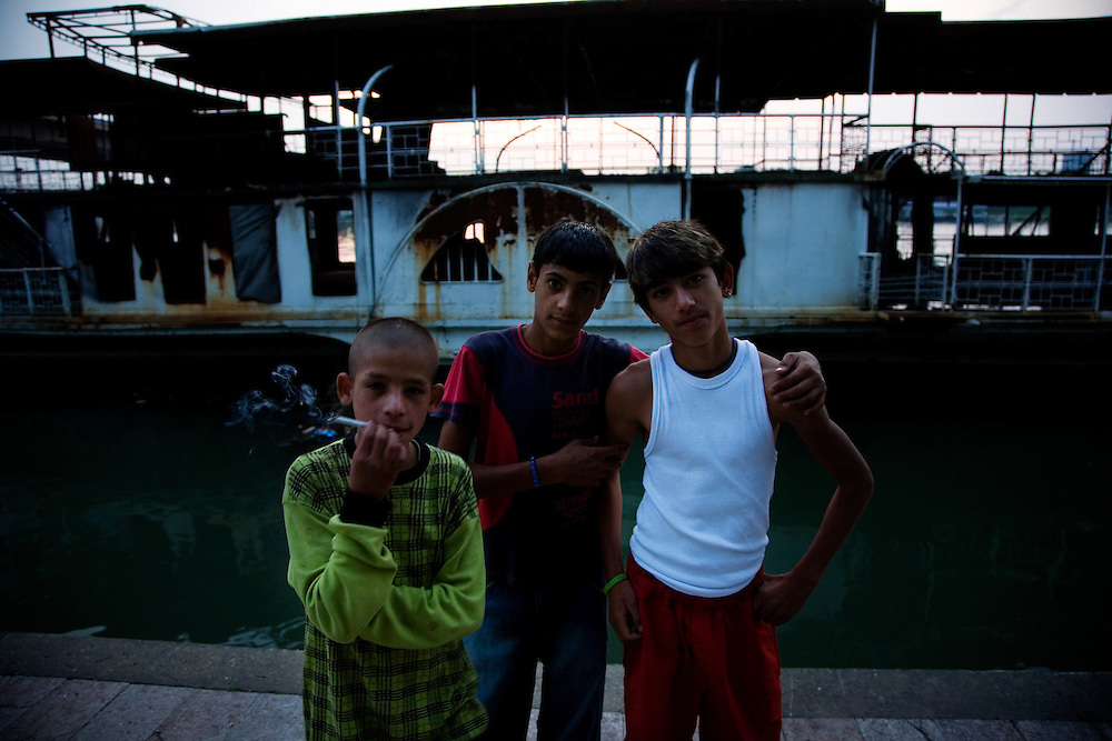 Boys along the Sava river, near the Stara Gazela camp.
