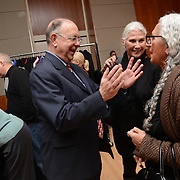 John Hayworth, from left, Gail Bruce and Sheila Metzner speak at the 2013 Native Art Market and preview evening party at the Smithsonian National Museum of the American Indian in New York City on December 7, 2013. <br />