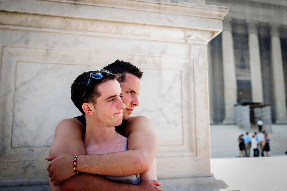 Gay marriage supporters Sam Knode, 23, of Bowling Green, VA and Chase Hardin, 20 of Phoenix, AZ, (front) wait to hear rulings on pending cases by the U.S. Supreme Court in Washington, D.C. on Tuesday. The Court limited the use of a key provision in the Voting Rights Act of 1965, invalidating the key enforcement provision. The Court failed to announce an ruling on the two same sex marriage cases before the Court. More rulings are scheduled for Wednesday.
